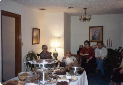 Family sitting around a buffet table
