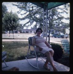 Woman sitting on porch