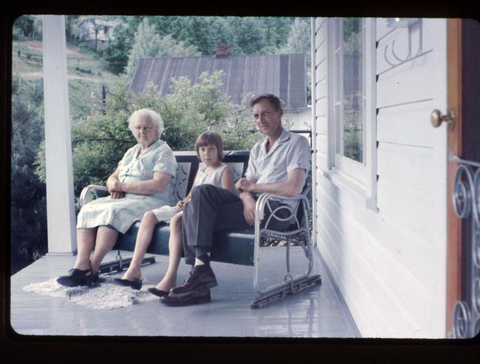 Family sitting on porch