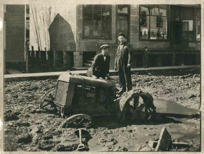 Two men with tractor stuck in mud. Neon, KY, 1924