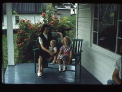 Woman and children sitting on a porch