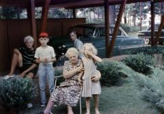 Exterior of family beside carport