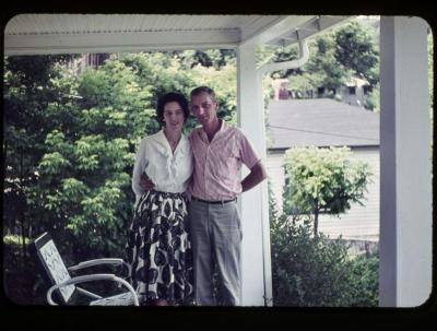 Man and woman standing together on front porch