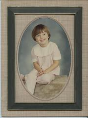 Framed photograph of a girl in a pink outfit
