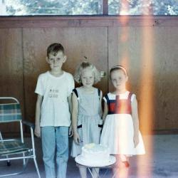 Children with a birthday cake