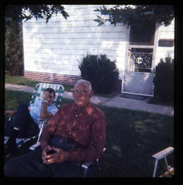 Two men sitting in lawn chairs