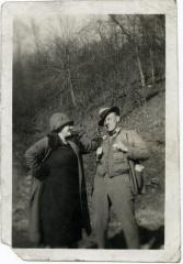 Man and woman posing for a photo outdoors