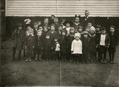 Group of children and a man.