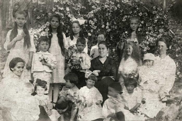 Group of women and children posing for photo