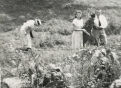 Four people in a field