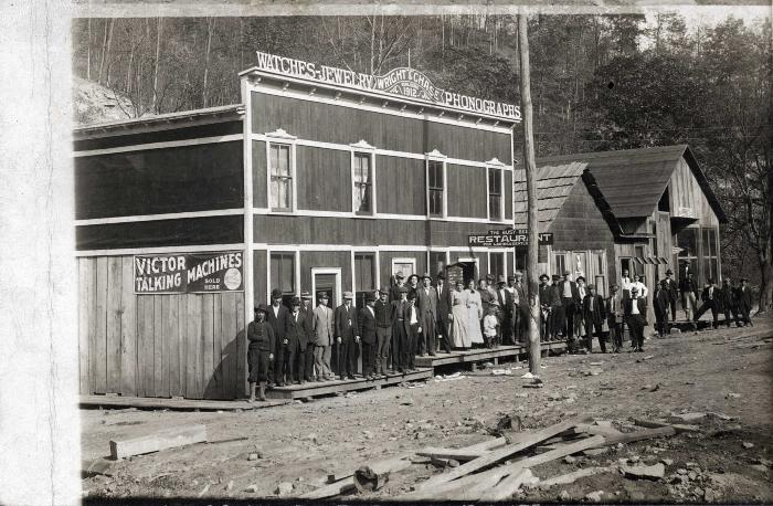 Large group standing outside store