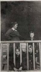 Woman and three children on a porch