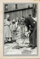 Woman using shovel at groundbreaking