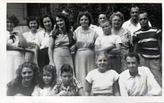 Group of men and women posing for a photograph