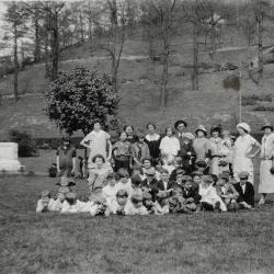 Group of adults and children posing for photo in Jenkins park