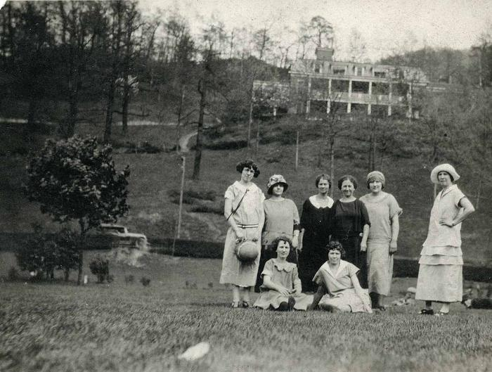 Group of women posing outdoors with a building in the background