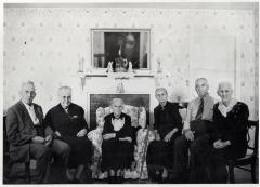 Group of people sitting in front of fireplace