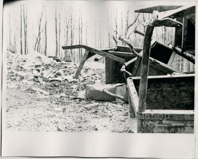 Production still of a pile of school desks, exterior - The Struggle of Coon Branch Mountain
