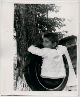 Production still of boy in tire swing - The Struggle of Coon Branch Mountain
