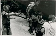 Production still of boys on seesaw - The Struggle of Coon Branch Mountain