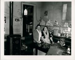 Man and woman standing behind a store counter
