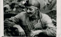 Coal miner in mining clothes and helmet