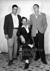 Studio portrait of 3 men in suits