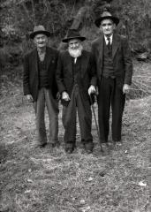 Portrait of three older men, one with cane