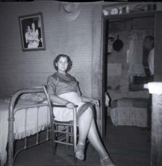 Unidentified woman sitting in chair