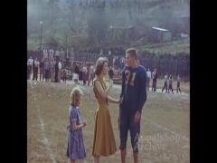 High school football game with cheerleaders (silent)