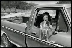 Woman and daughter in pickup truck