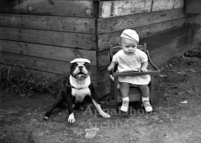 Toddler and dog, both wearing hats