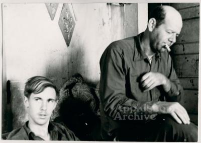Production still of young man and older man - The Struggle of Coon Branch Mountain
