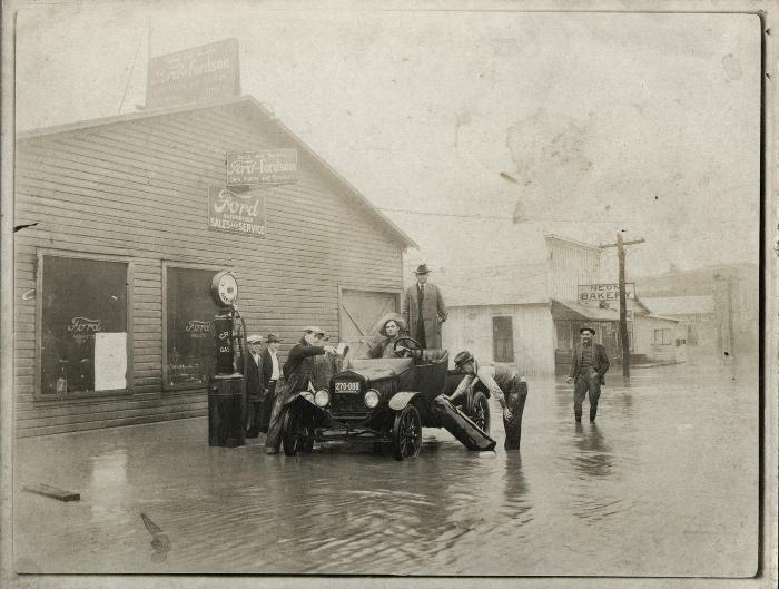 Car stuck on flooded street