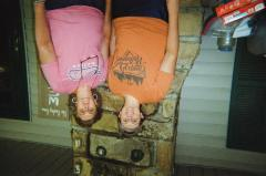"""Two women on porch, """"The Owsley Crew"""" sign in background"""