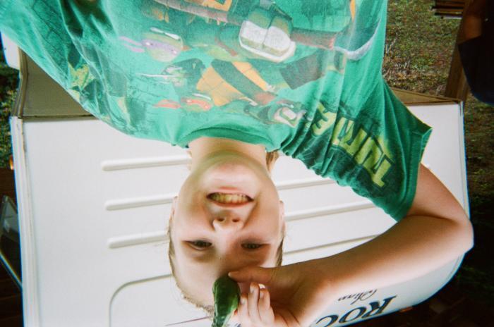 Girl in t-shirt holding vegetable