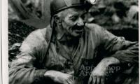 Frank Jackson in mining clothes and helmet.