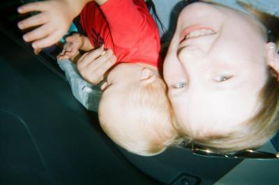 Smiling girl holding toddler