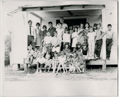 Production still of posed group of children and adults, exterior - The Struggle of Coon Branch Mountain