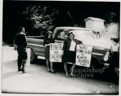 Production still of people with protest signs - The Struggle of Coon Branch Mountain