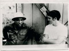 Coal miner and young man in conversation (In Ya Blood)