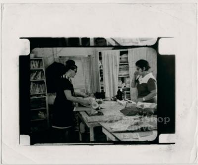 Film still of two seamstresses - Millstone Sewing Center