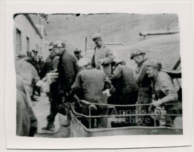 Production still of group of coal miners debording transport, exterior - UMWA 1970:  A House Divided