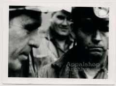 Film still of miners in hats (exterior) - UMWA 1970:  A House Divided