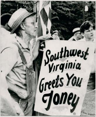 Production still of man holding sign at UMWA rally - UMWA 1970:  A House Divided